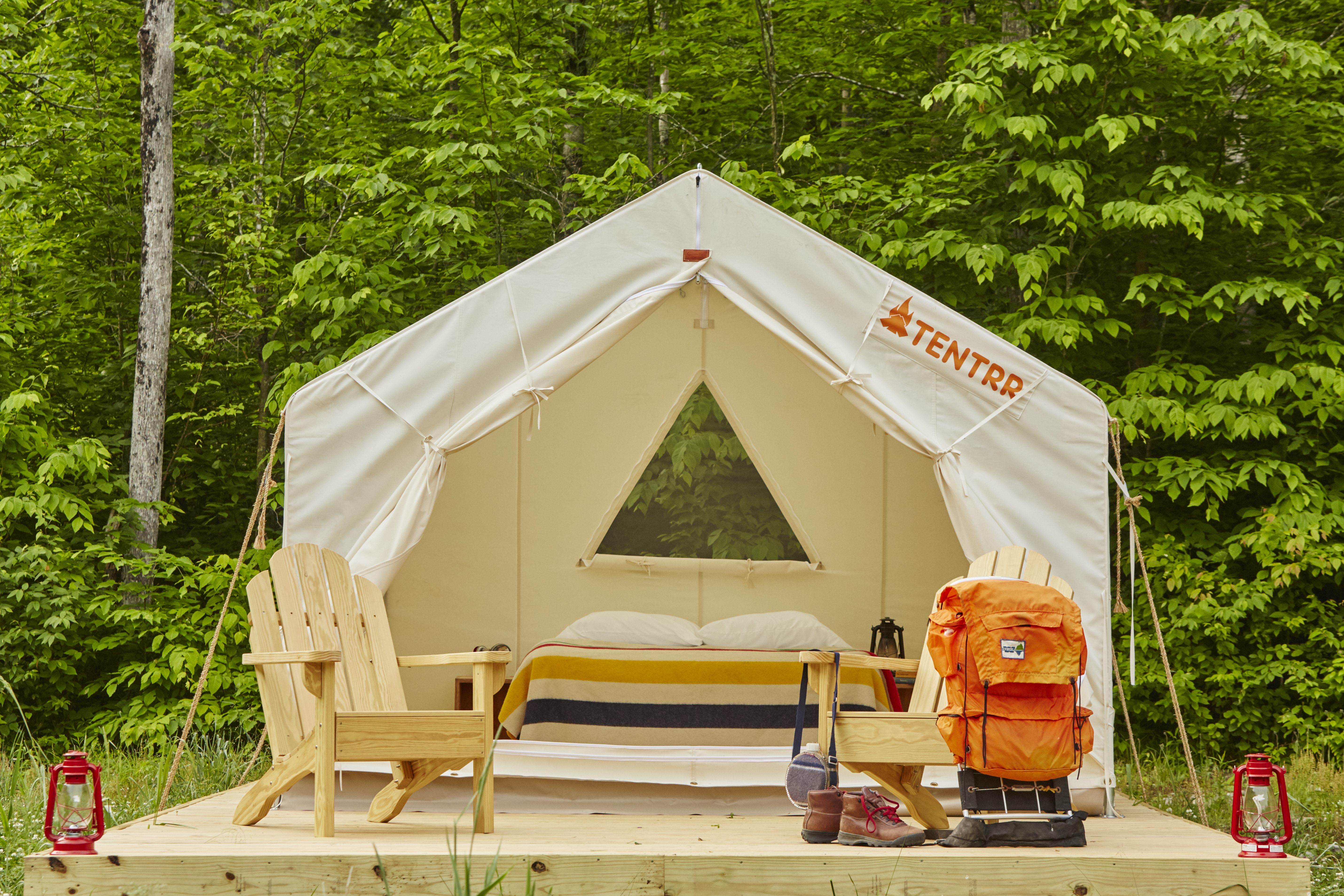 A Tentrr tent complete with bed, chairs and amenities for camping