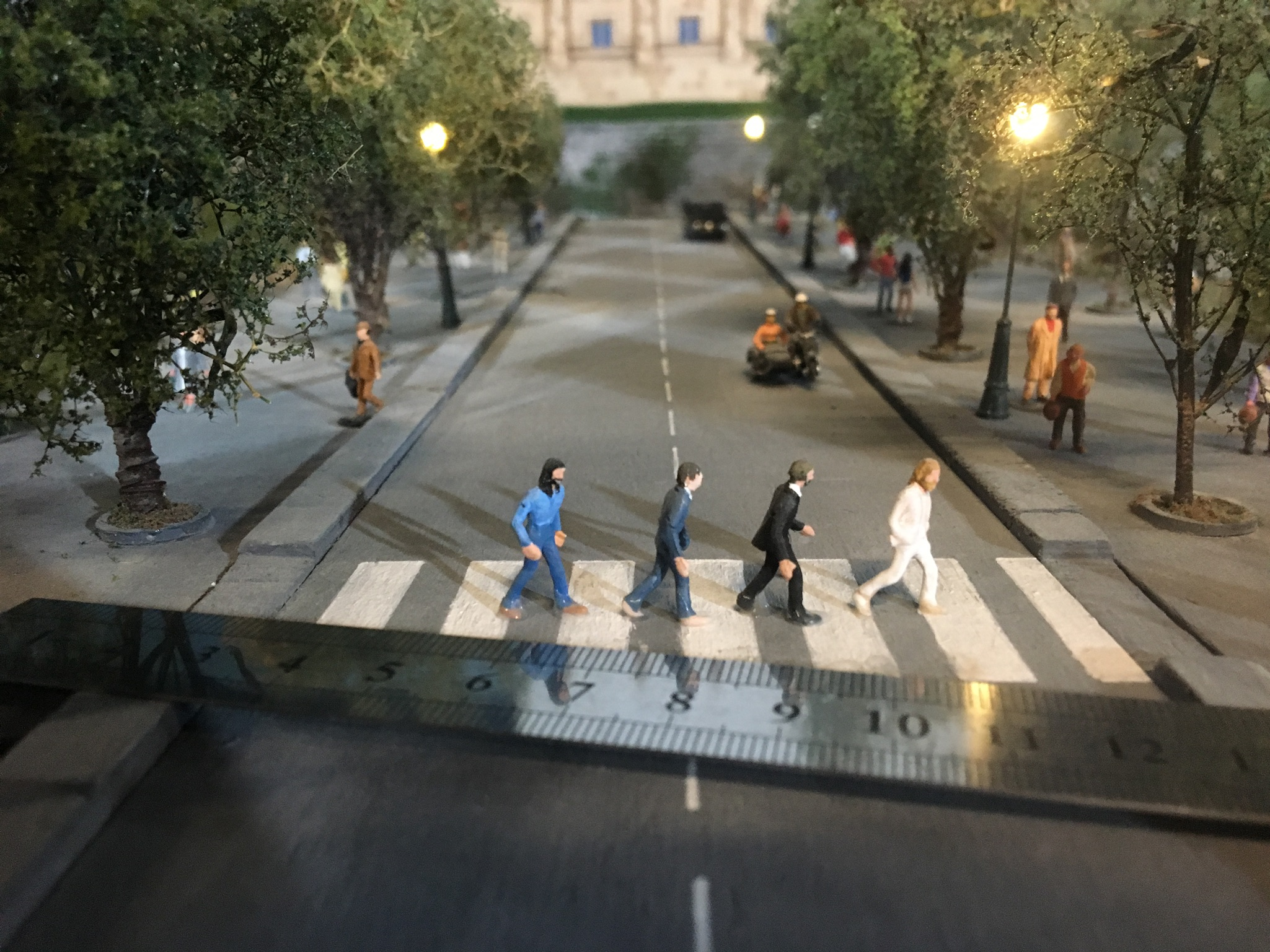 The Beatles walk across a miniature Abbey Road at Gulliver's Gate .