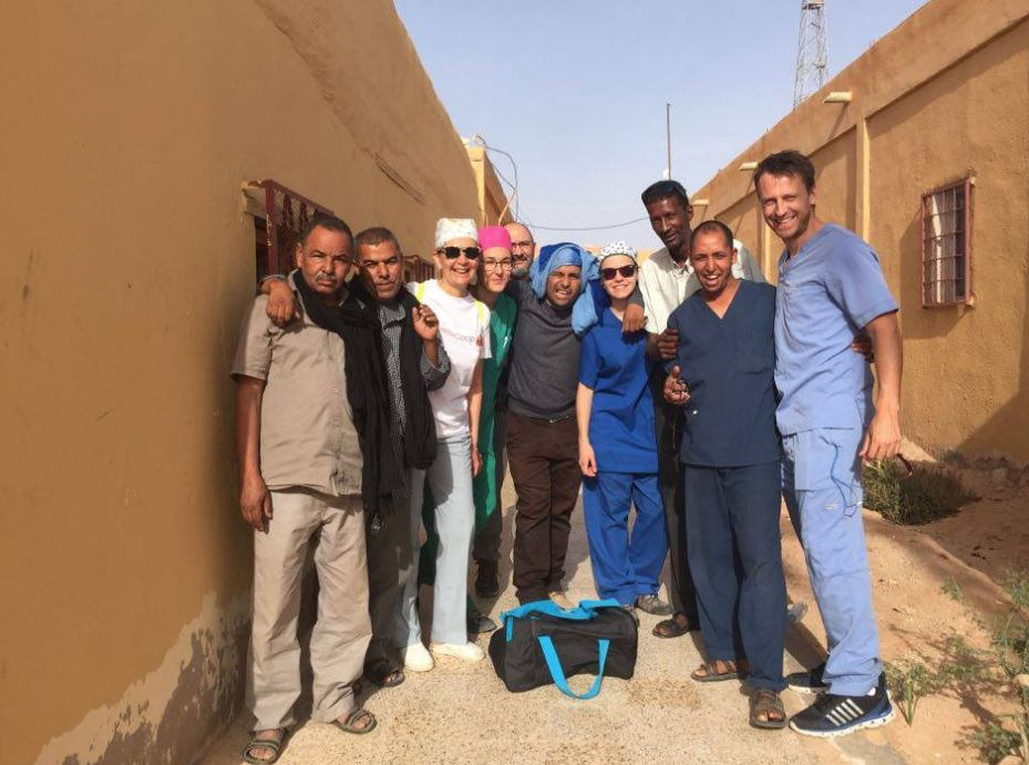 Dustin (extreme right) volunteering in a refugee camp in Saharawi in Africa.