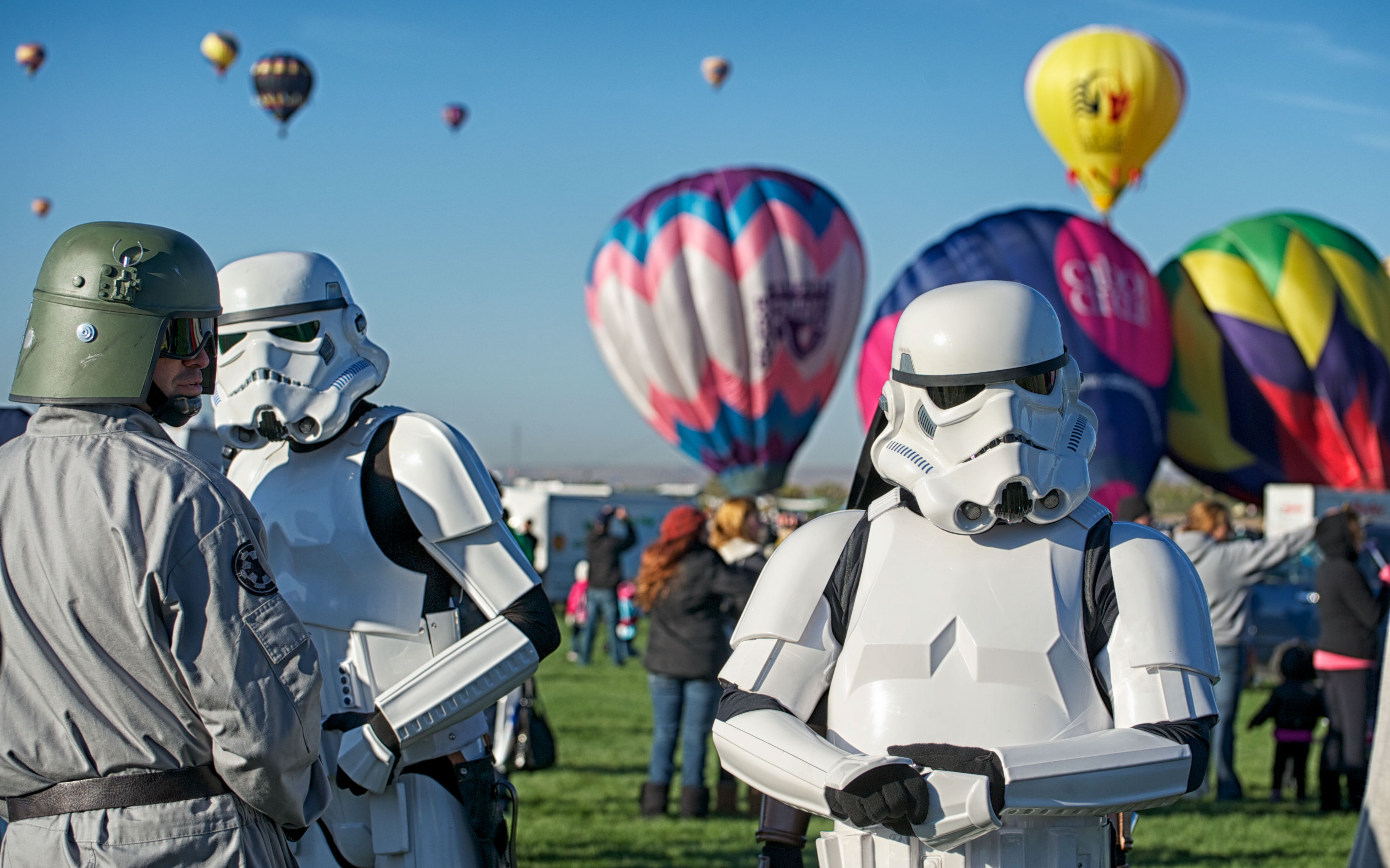 Storm Troopers with several hot air balloons in the background at the Albuquerque International Hot Air Balloon Fiesta, Albuquerque, New Mexico.