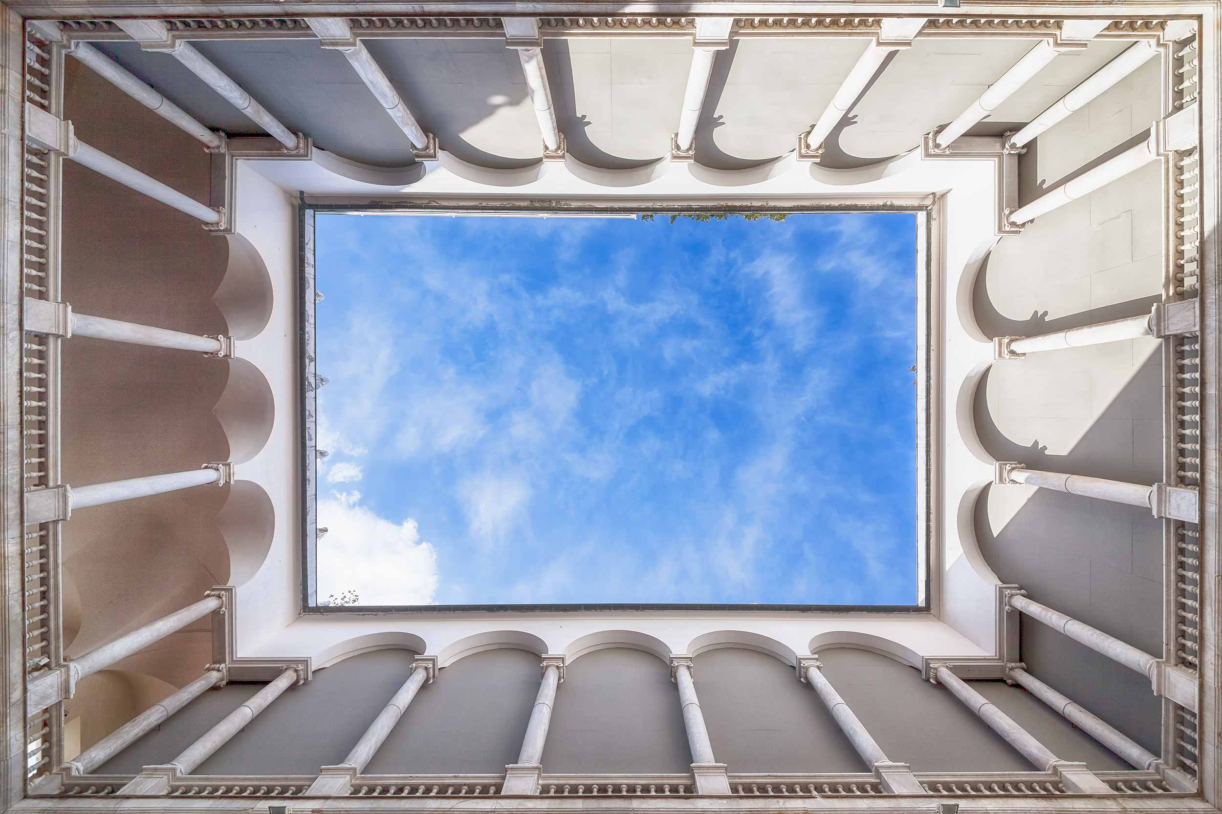 A courtyard in genoa italy and a blue sky overhead
