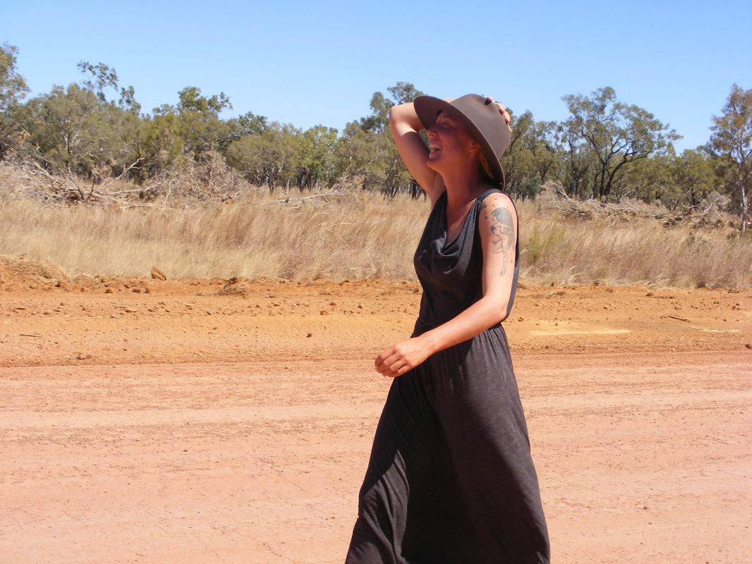 Angela walking on the road in Australia.