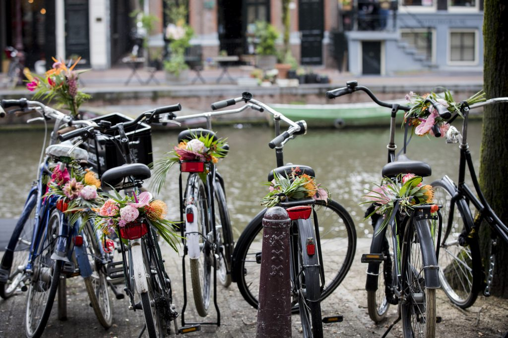 A team of 'floral vandals' took to the streets of Amsterdam and decorated hundreds of bikes. Image: Tristan Fewings/Getty Images for Kimpton De Witt hotel