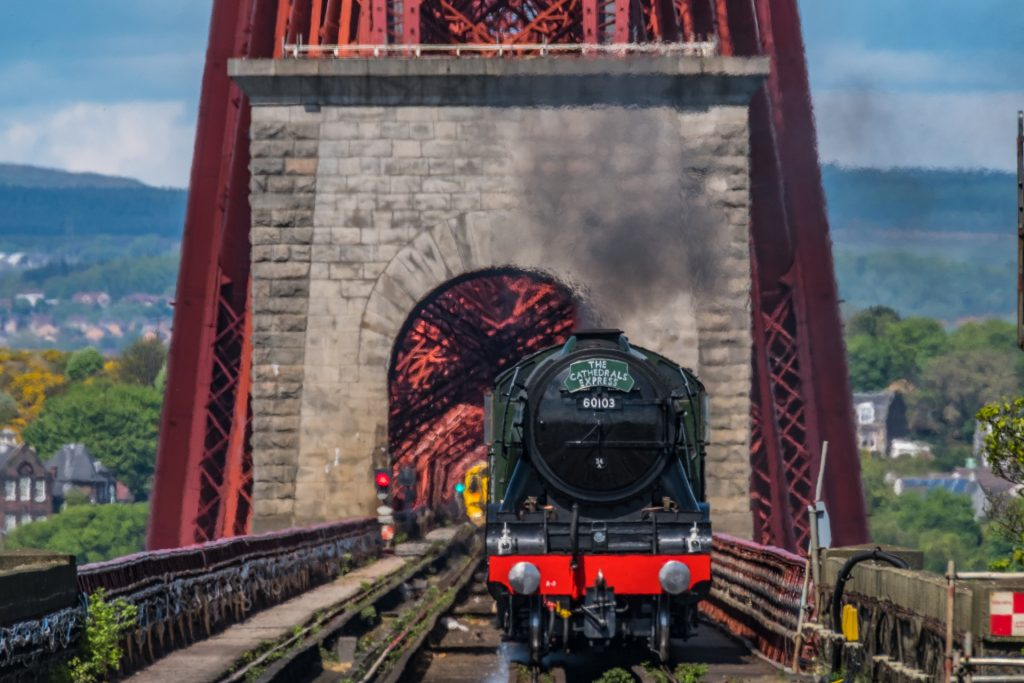 The Flying Scotsman passes over the Forth Rail Bridge to South Queens Ferry.
