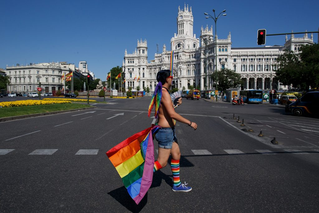 A reveller walks the streets next to Cibeles Square before the 2016 Madrid Gay Pride. Image: Pablo Blazquez Dominguez/Getty Images