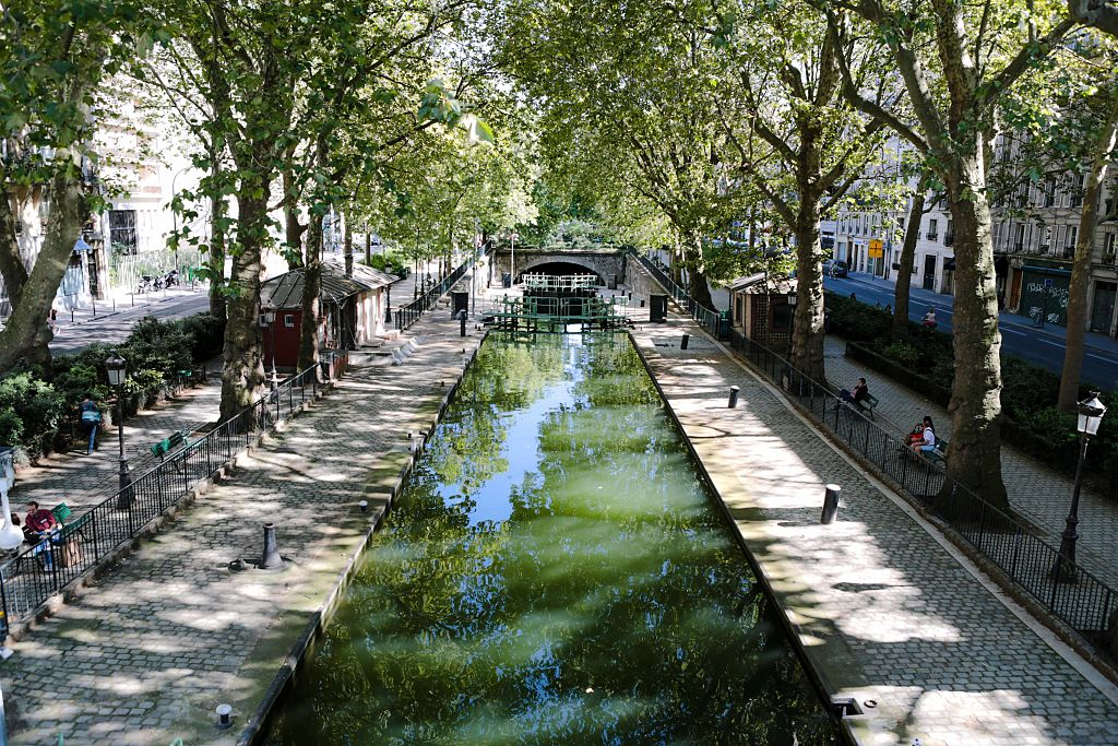 Reflection of Paris, on the Canal Saint-Martin, which connects the Canal de l'Ourcq to the river Seine.