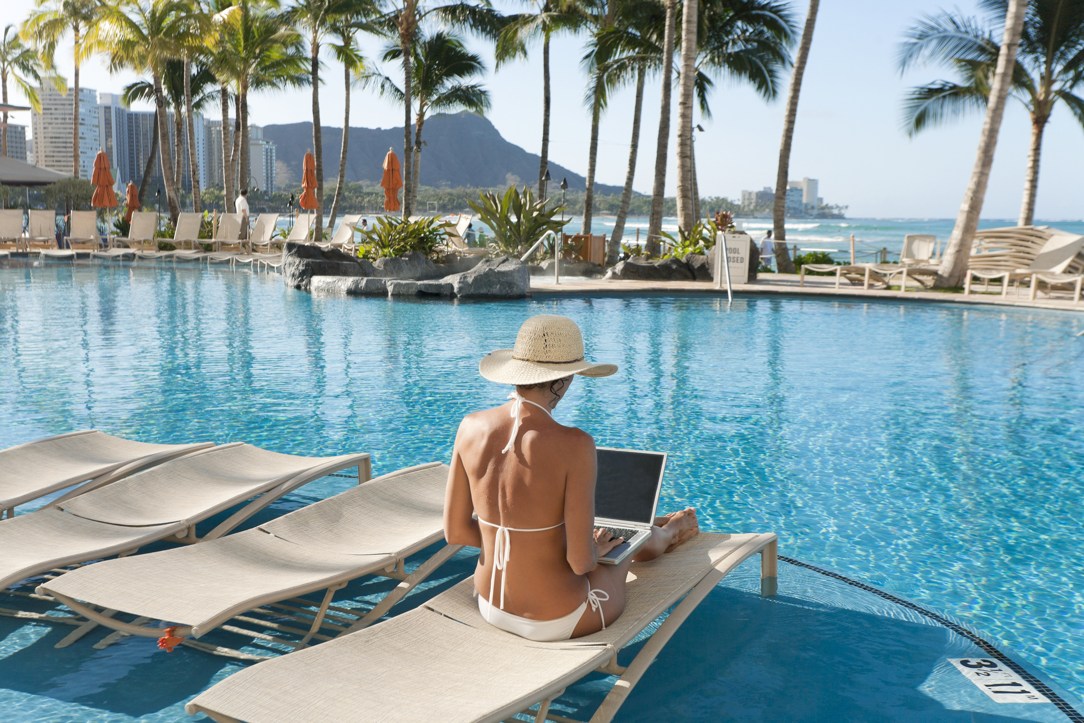 Many travellers on holidays find it hard to switch off online. Image: Monica and Michael Sweet
