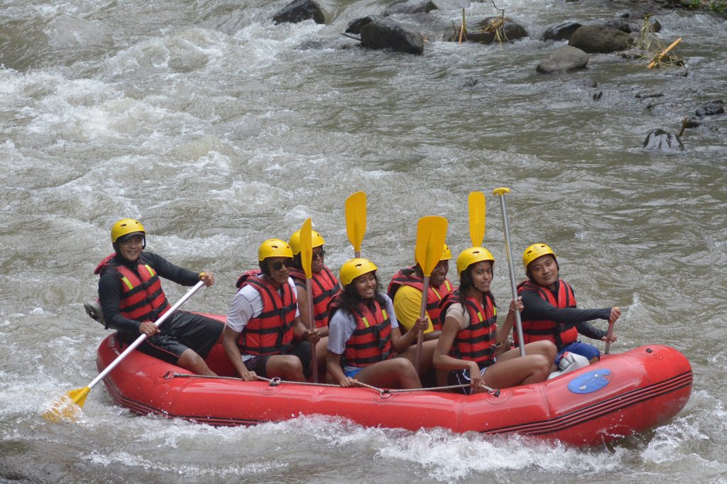 Former US president Barack Obama. his wife Michelle and daughters Sasha and Malia go rafting at Bongkasa Village in Badung on Bali island. Image: STR /AFP/Getty Images