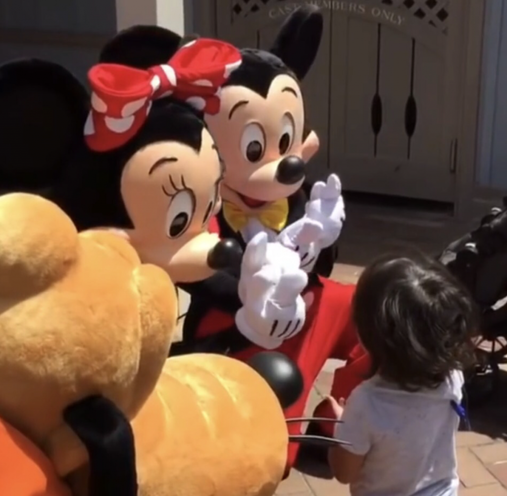 Minnie and Mickey signed for this deaf little boy in Disney. Image: Olive Crest
