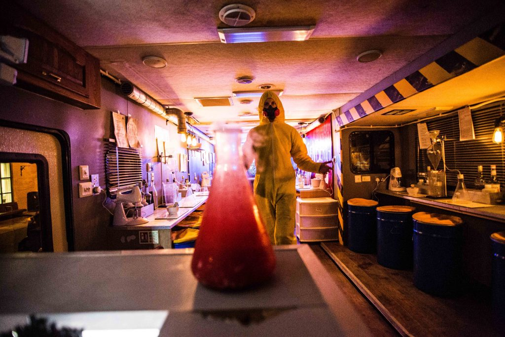 A bartender in a hazardous suit inside the ABQ breaking bad cocktail bar