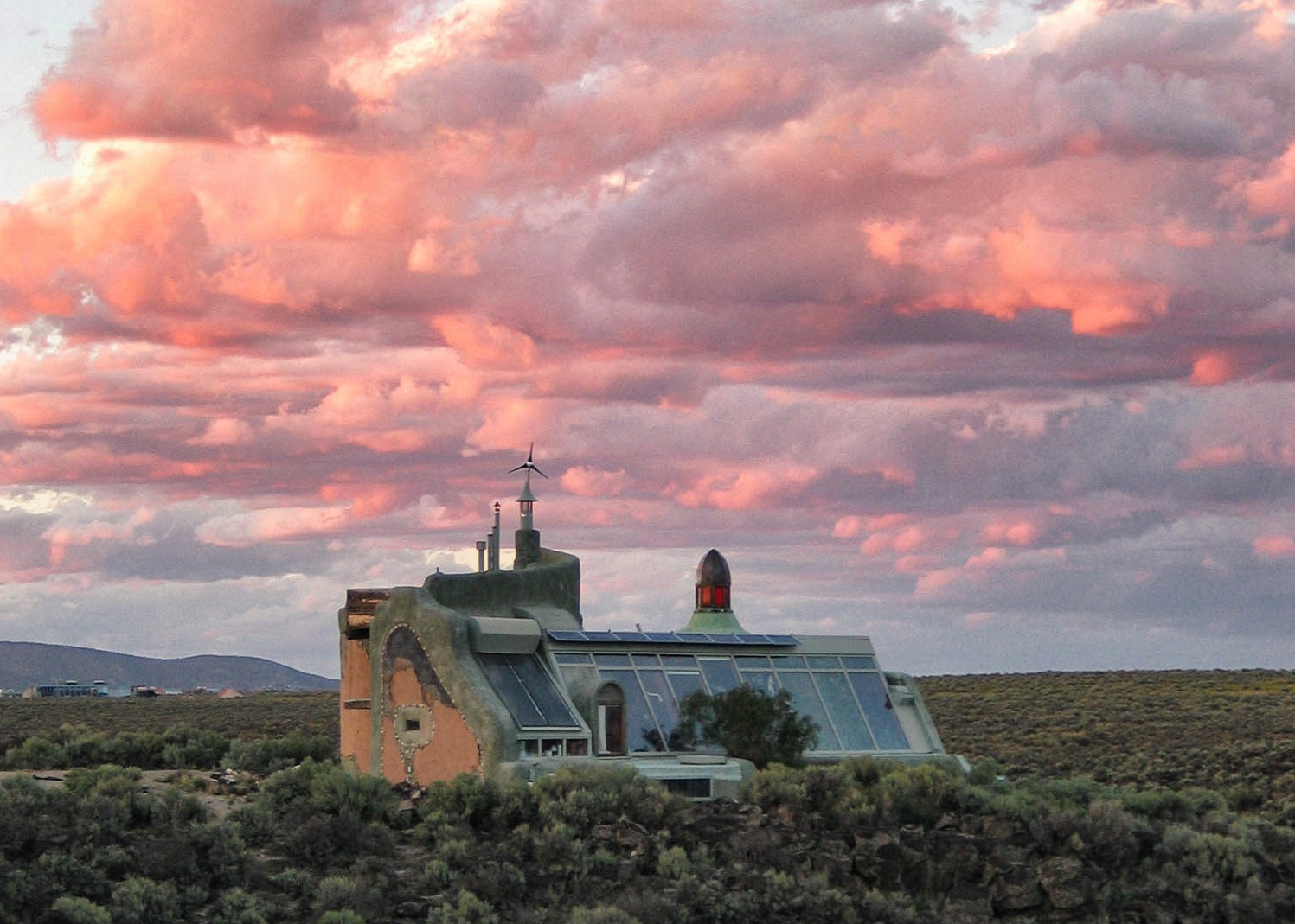 The alien-looking exteriors of an Earthship.