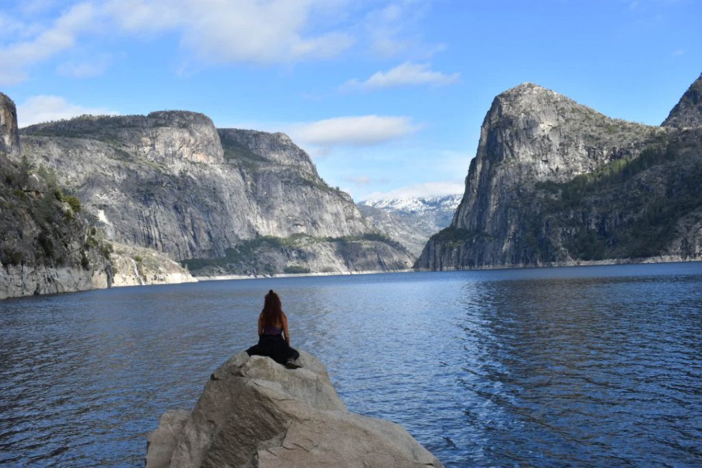Incredible images show Emily (26) sitting overlooking a shimmering lake.