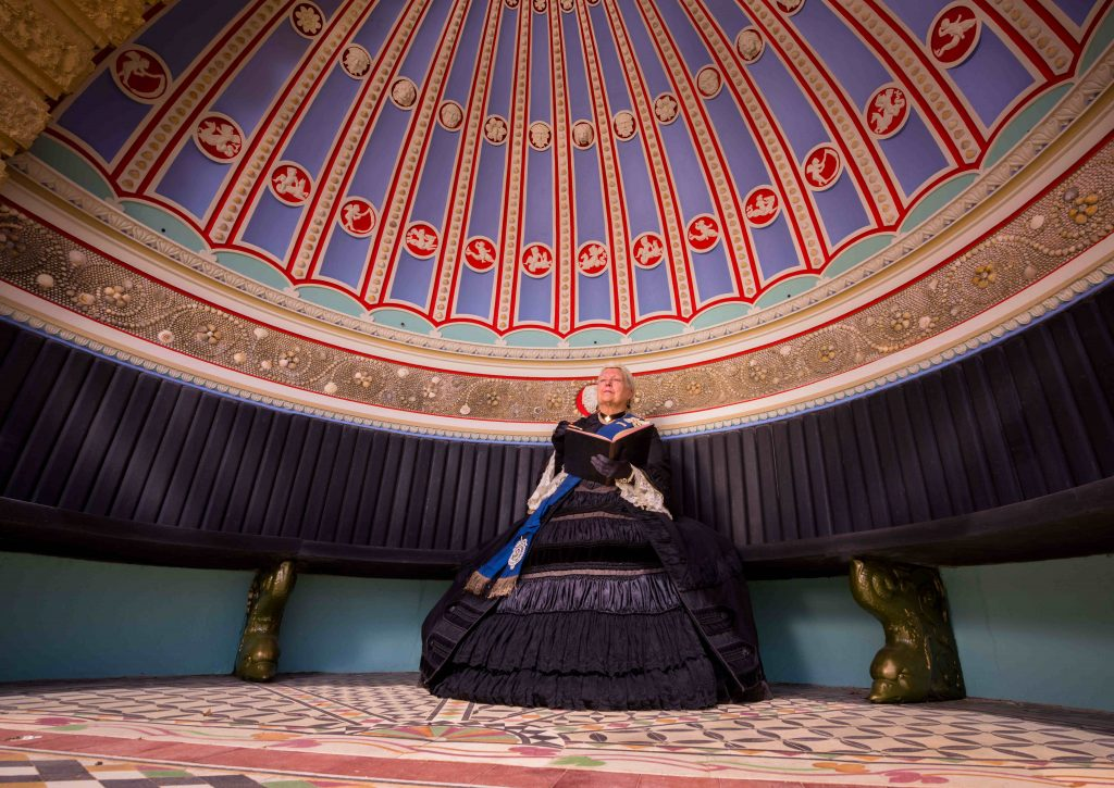 A Queen Victoria re-enactor sits in the Shell Alcove, which has been refurbished.