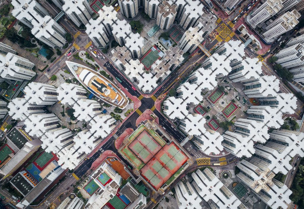 A gridlike pattern of buildings in Hong Kong taken by drone from high above the city