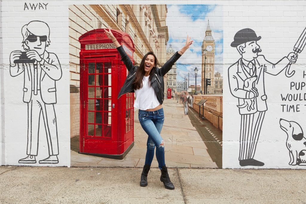 A woman poses in front of the London snapshot