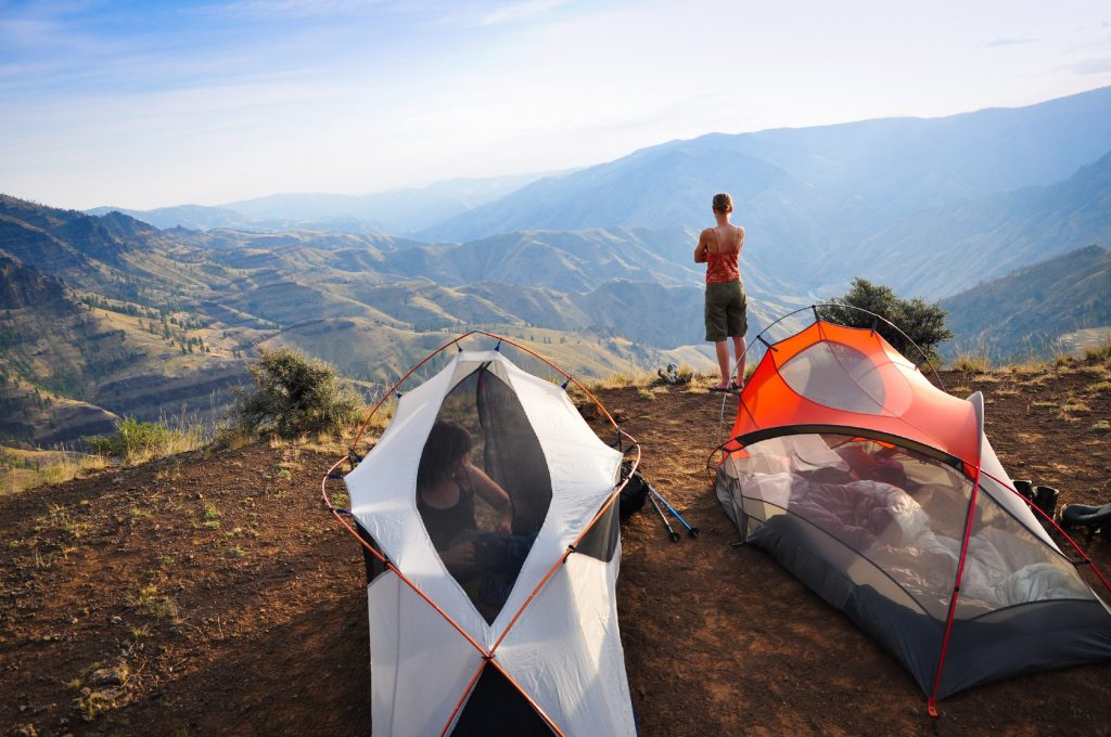 A hiker admires the view across Hells Canyon from her campsite on a backpacking trip.