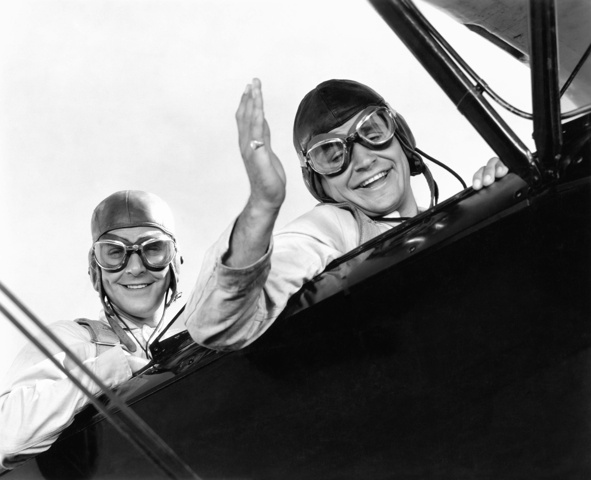 Two pilots in a vintage airplane
