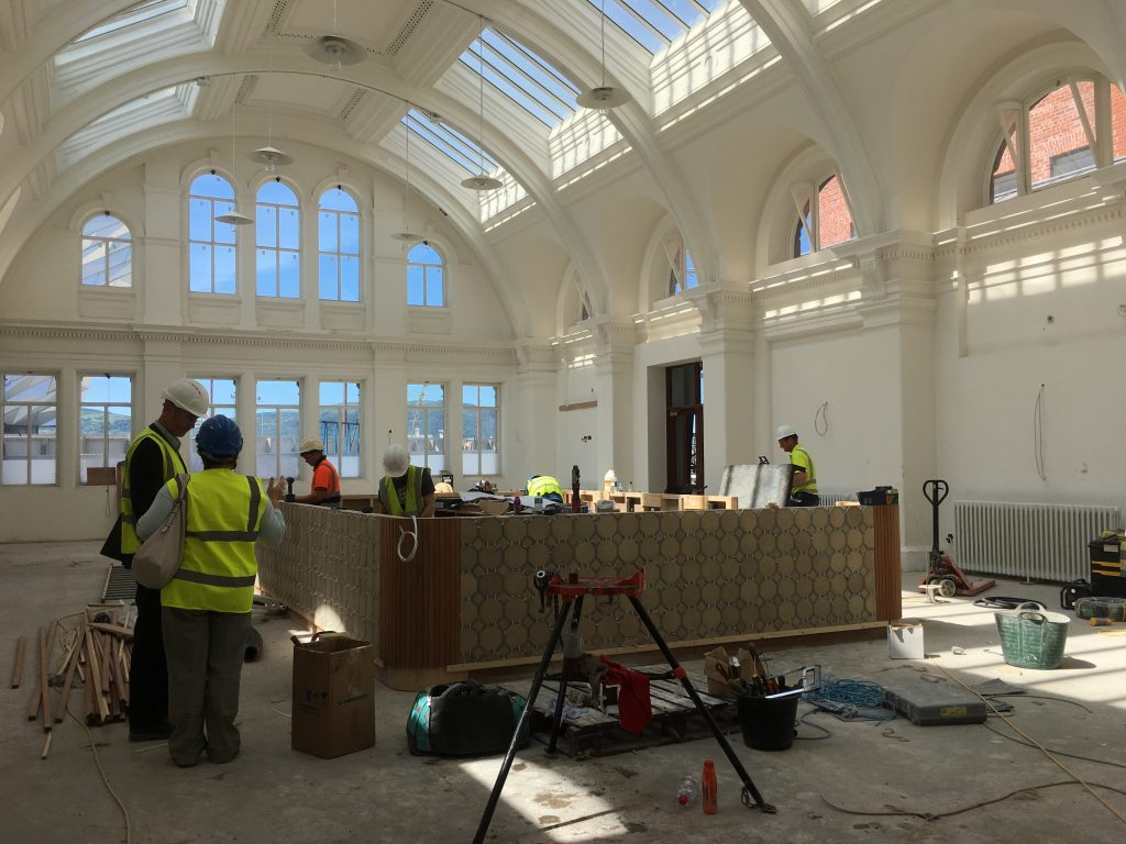 The new Drawing Room bar features the same tiles that lined the Titanic's swimming pool. Image: Titanic Foundation