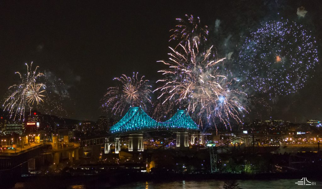 The Jacques Cartier Bridge with fireworks overhead to mark the first illumination.