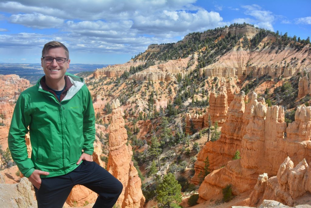 Mikah in front of Fairyland Canyon in Bryce Canyon National Park.