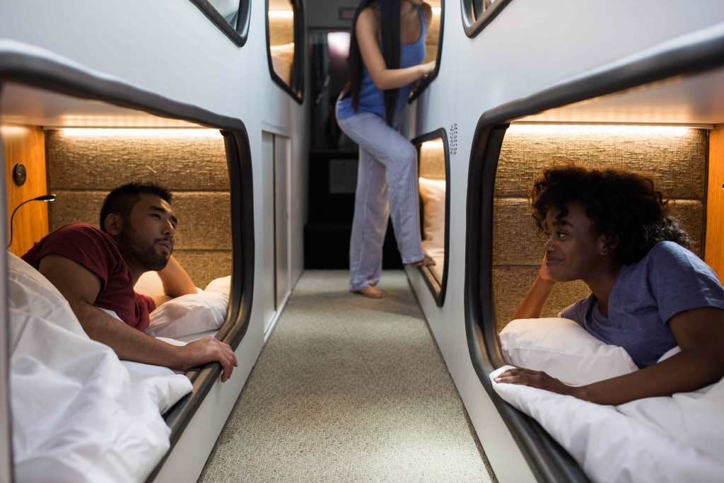 Passengers lay in their sleeping pods on board a Cabin bus.