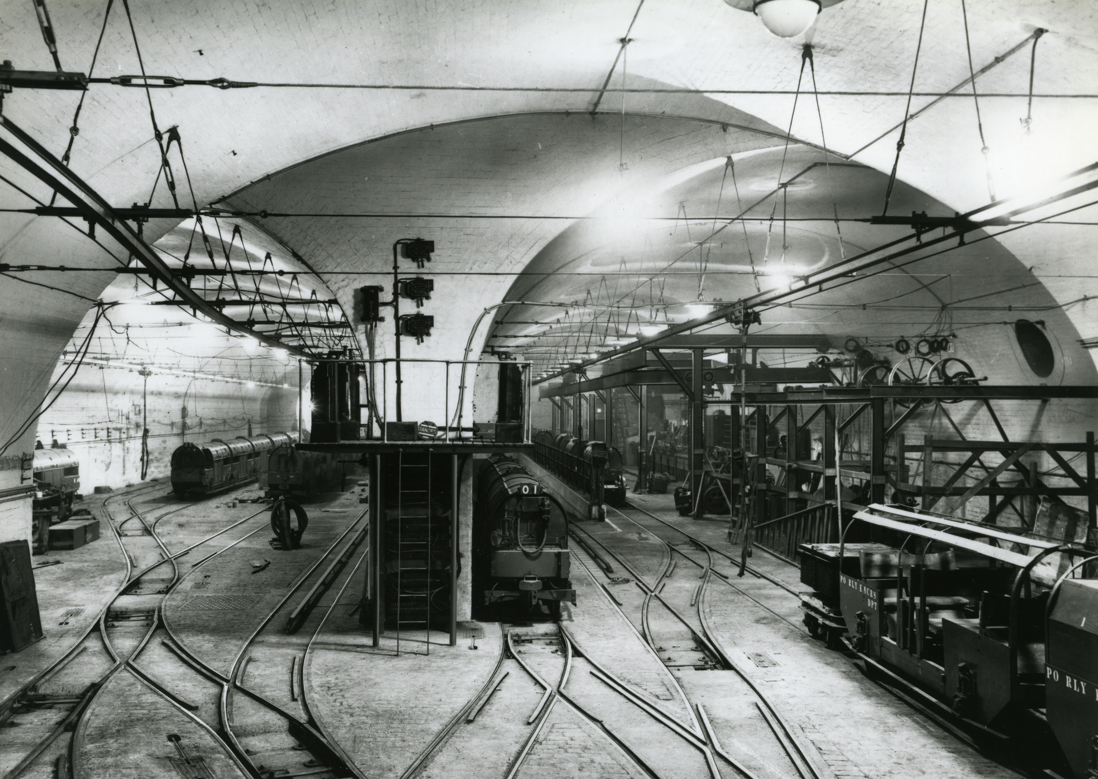 An old photograph from The Royal Mail Group archive showing the car depot of workshop of the rail service at display at The Postal Museum