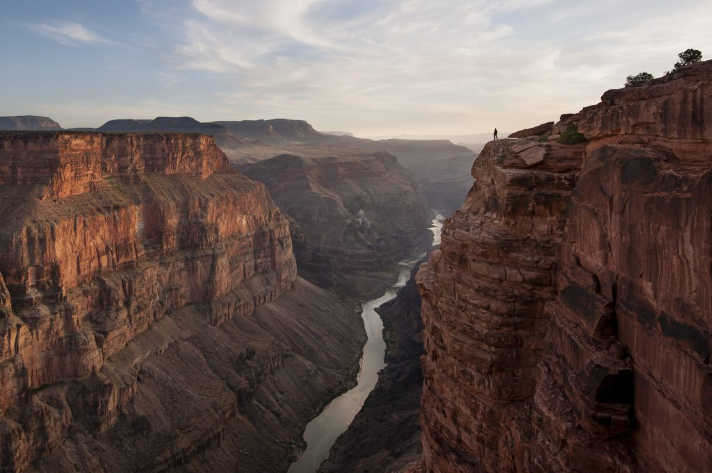 A man looking out over the Grand Canyon at Toroweap Point. Grand Canyon, Arizona