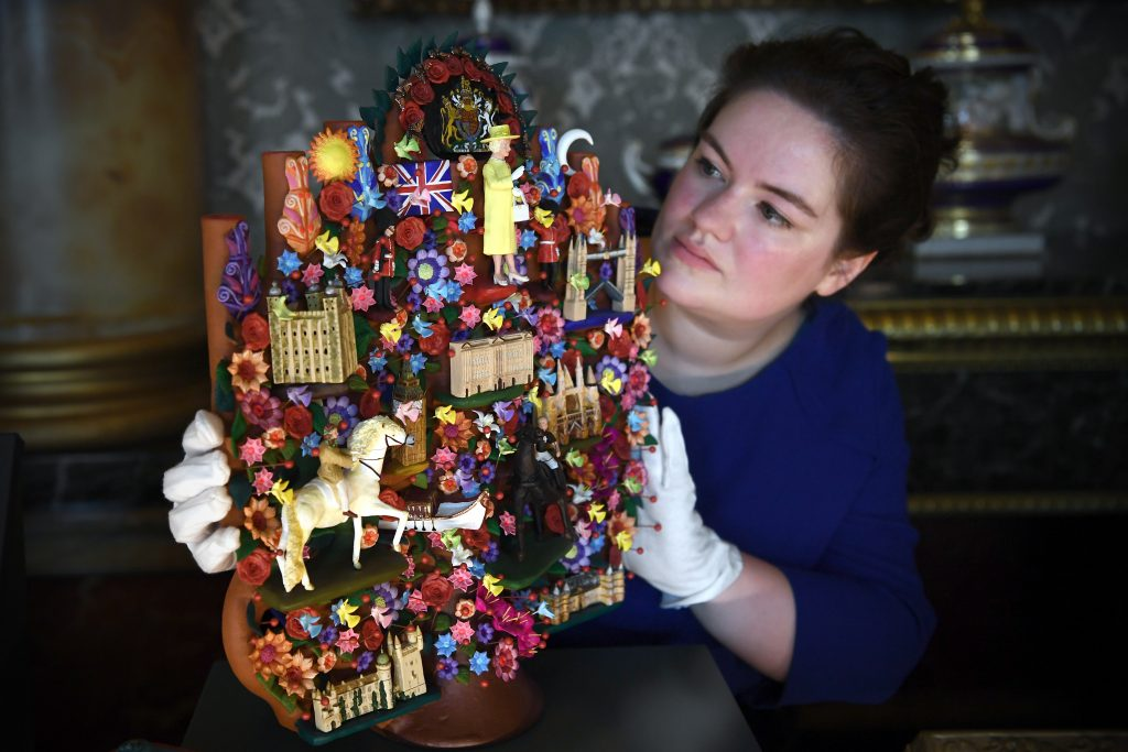 A member of staff poses with a 'Tree of Life' art piece given to Queen Elizabeth II by President Enrique Pena Nieto of Mexico during his 2015 State Visit.