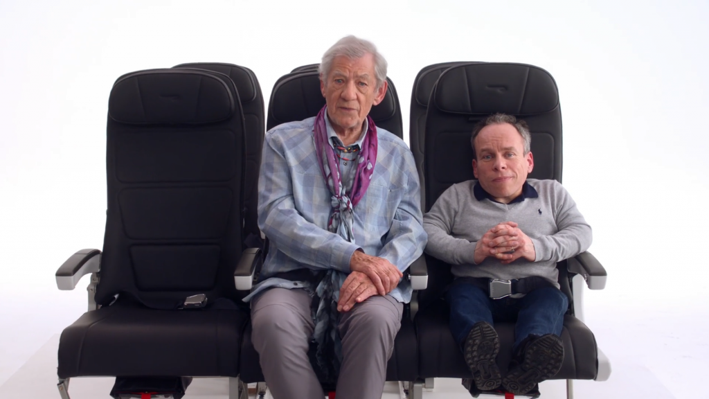 Sir Ian McKellen and Warwick Davis in the BA safety video. Image: British Airways