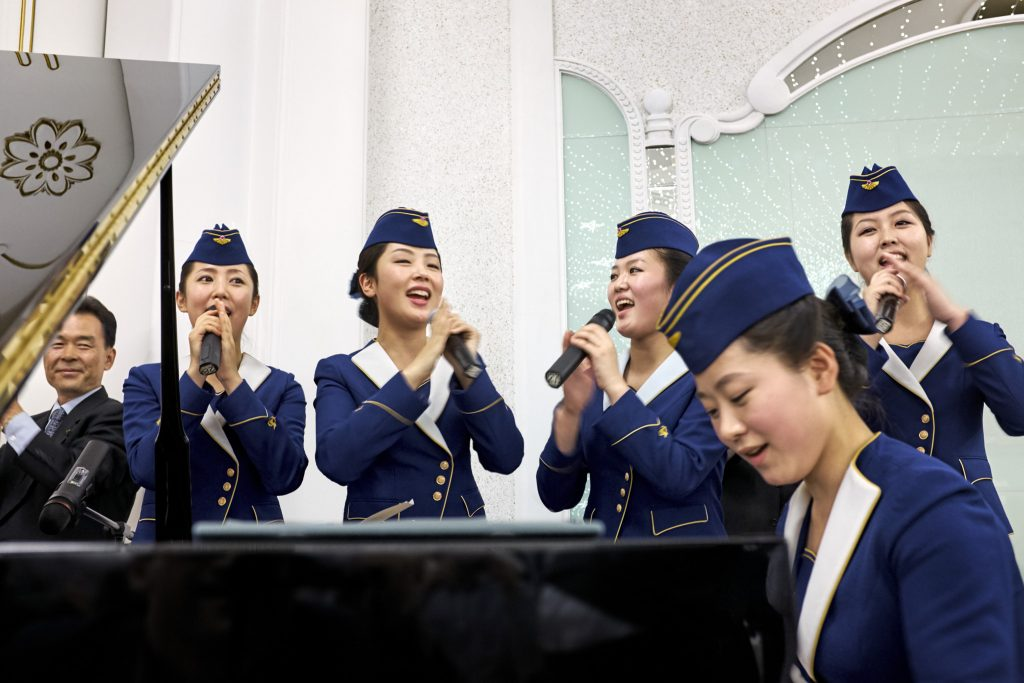 A crew sing songs in full uniform.