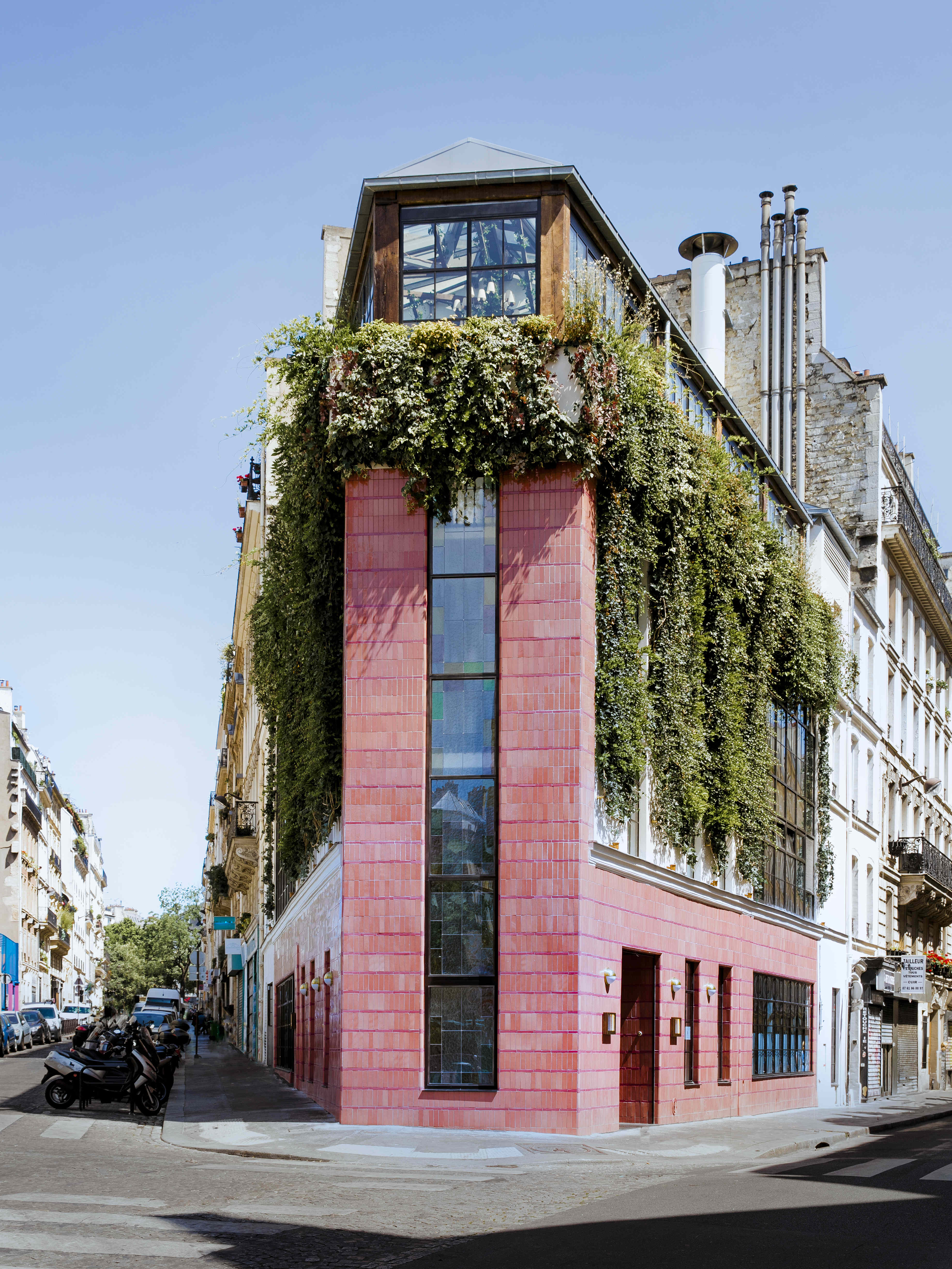 The exterior of Pink Mamma in Paris is actually pink and covered in plants.