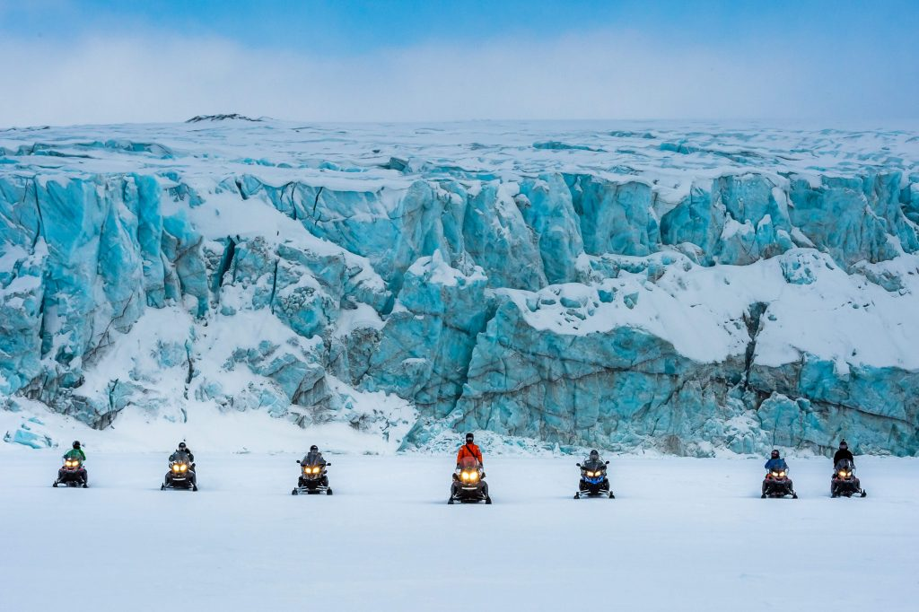 Exploring the glacier on snowscooters