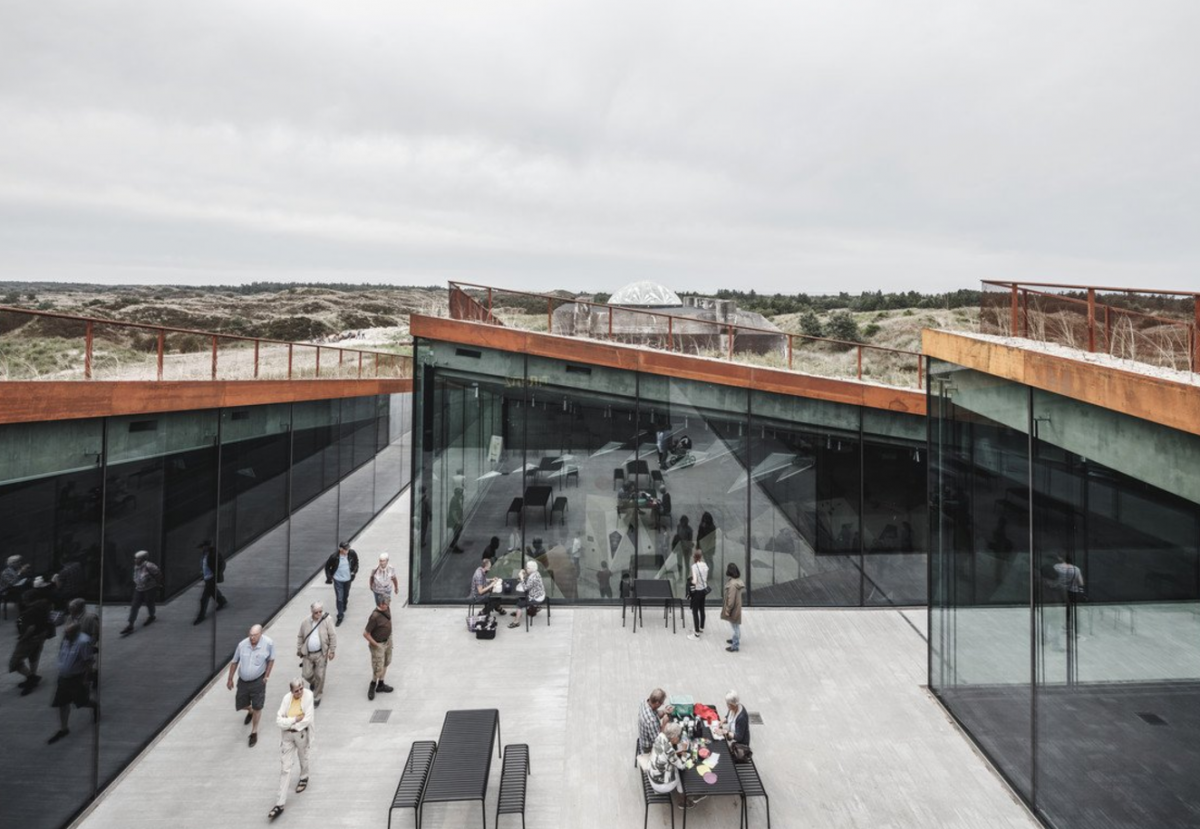 The new TIRPITZ is located in Denmark and expands a historic German WWII bunker into a cultural complex.