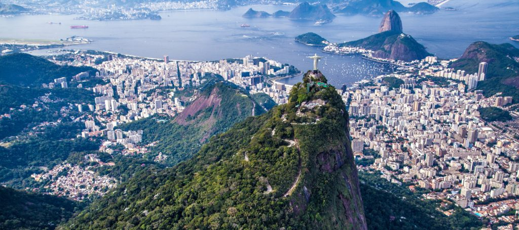 Aerial view of Christ the Redeemer overlooking Sugarloaf and Rio de Janeiro.