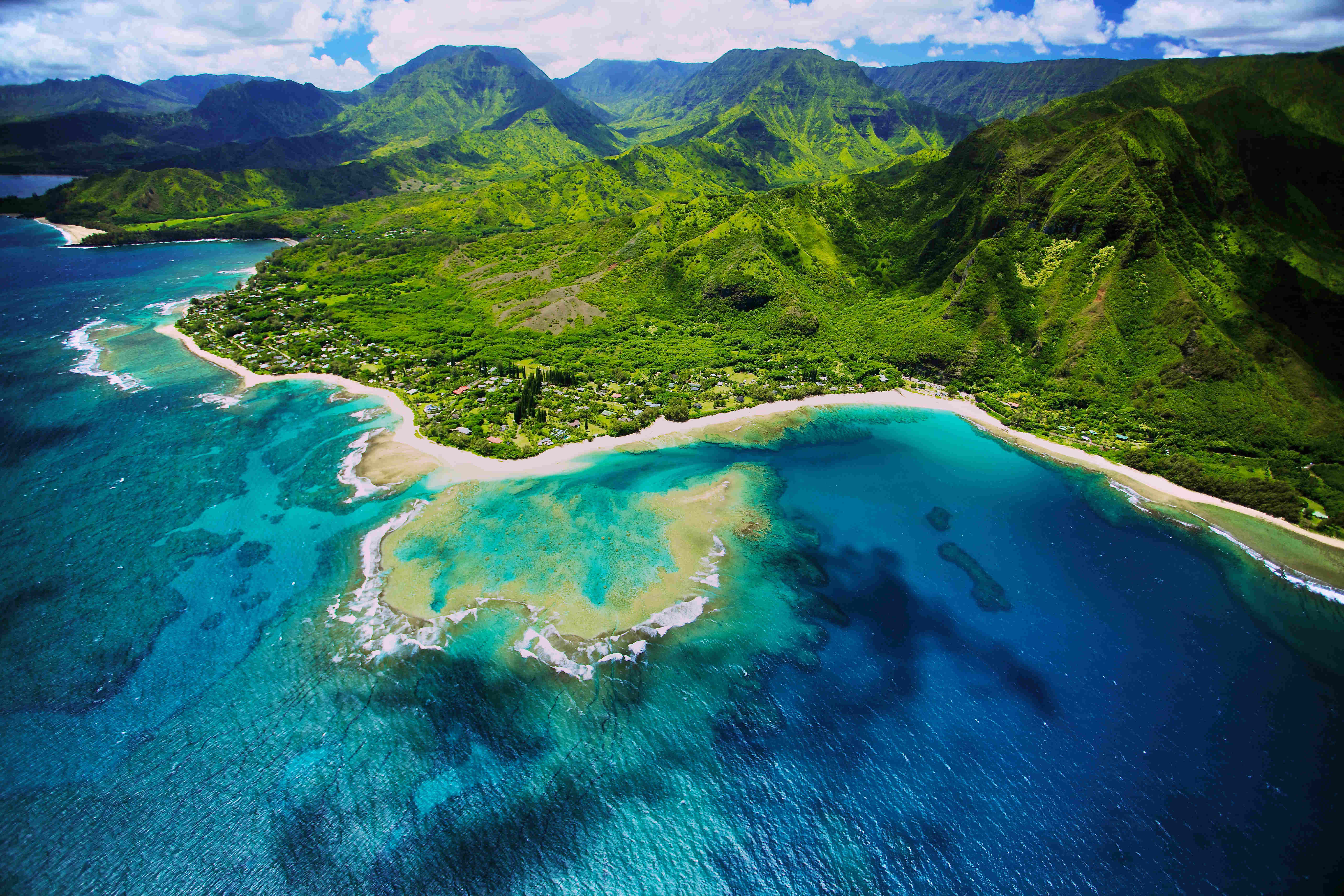 An aerial photo of Tunnels beach. Tunnels is located on Kauai's North Shore and is named after the tunnels that snorkelers and divers can observe when navigating the reef.