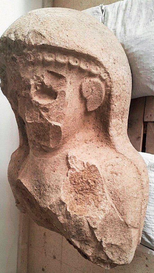 Discovered head of ancient 3000 year old statue of a woman.