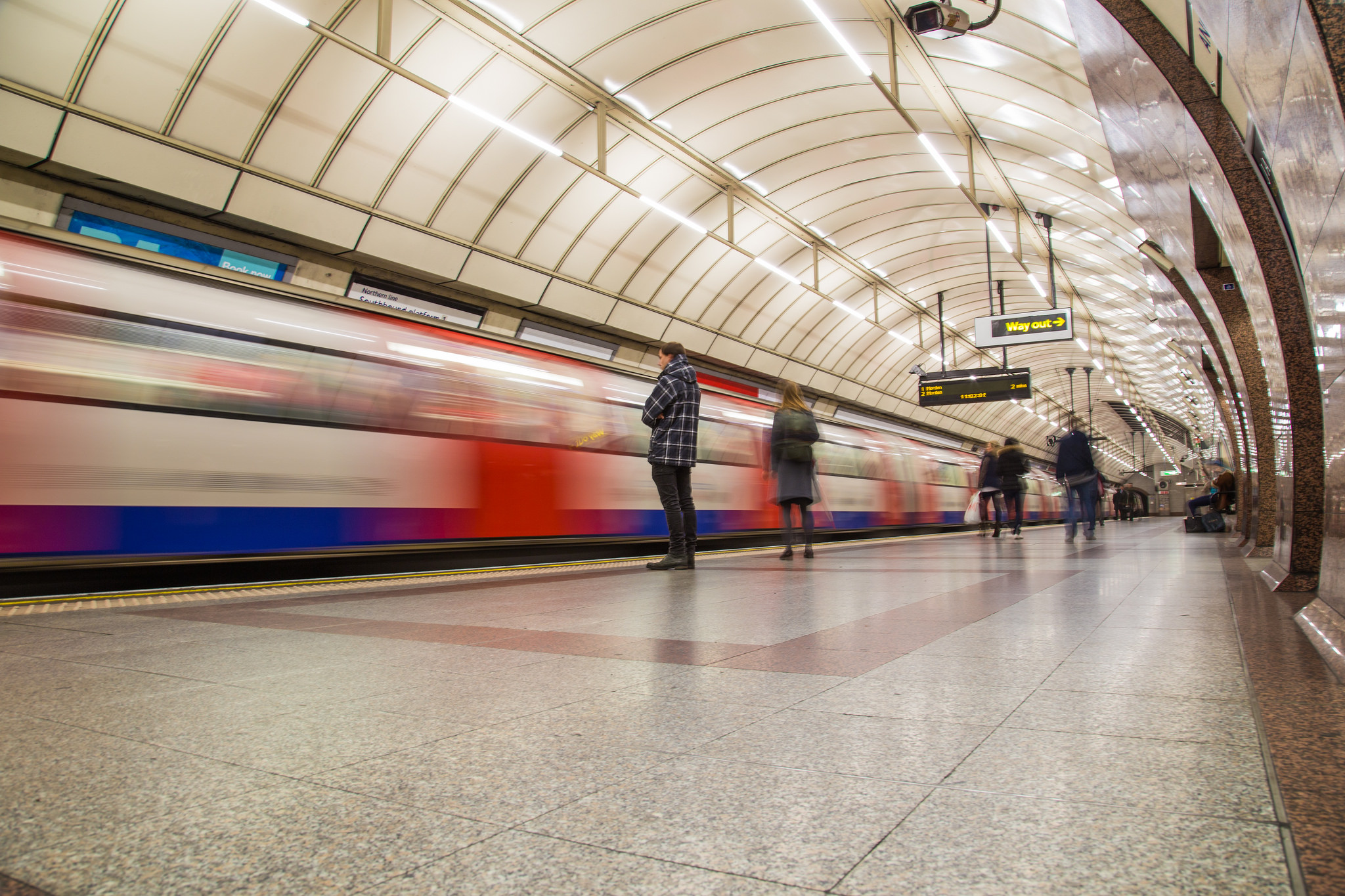 a train goes past a London underground station