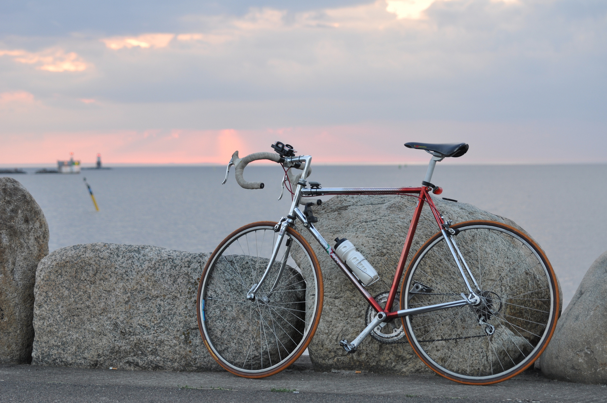 A bike parked along the sea wall at Malmö Harbour.