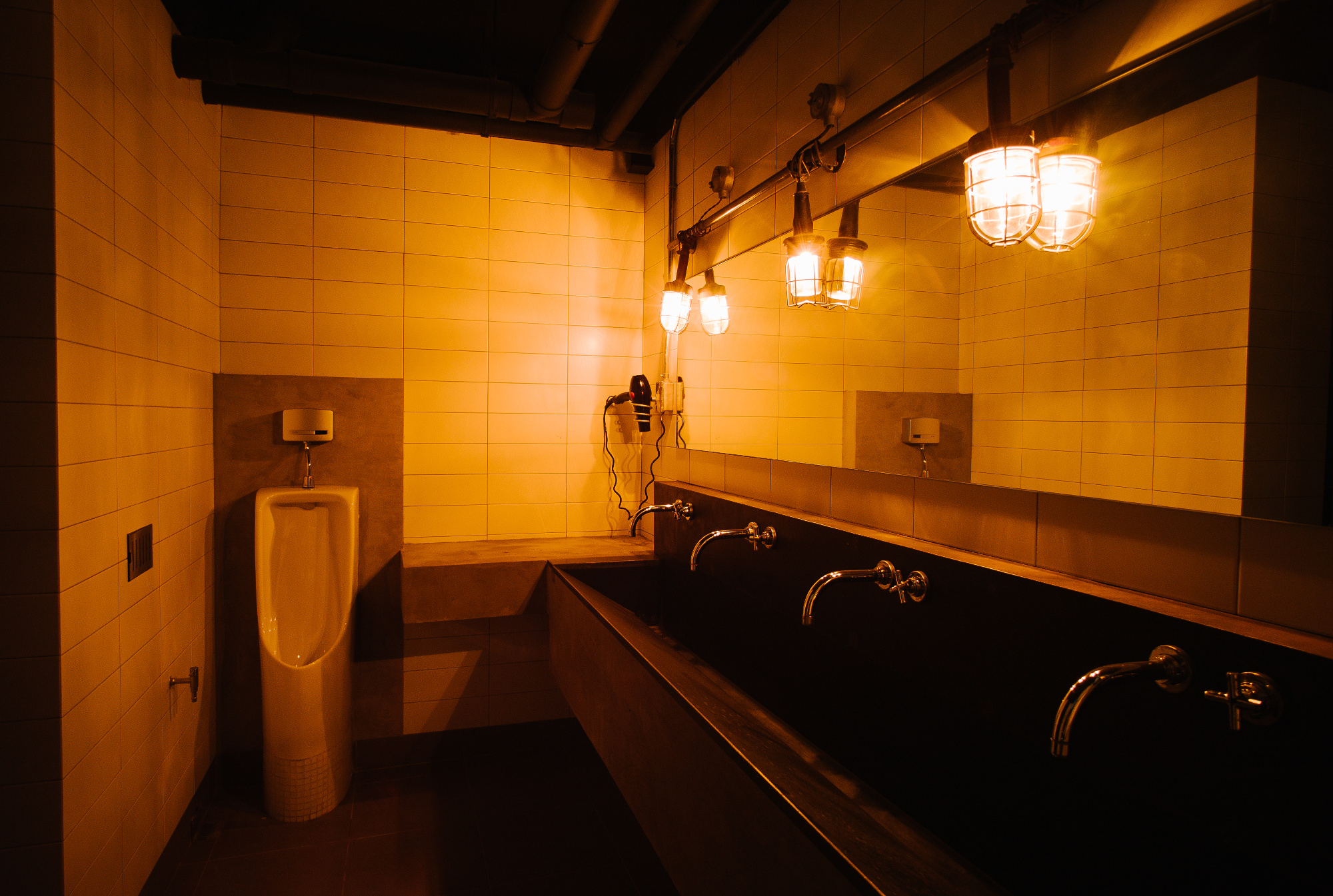 The bathrooms of Sook Station prison style hotel in Bangkok