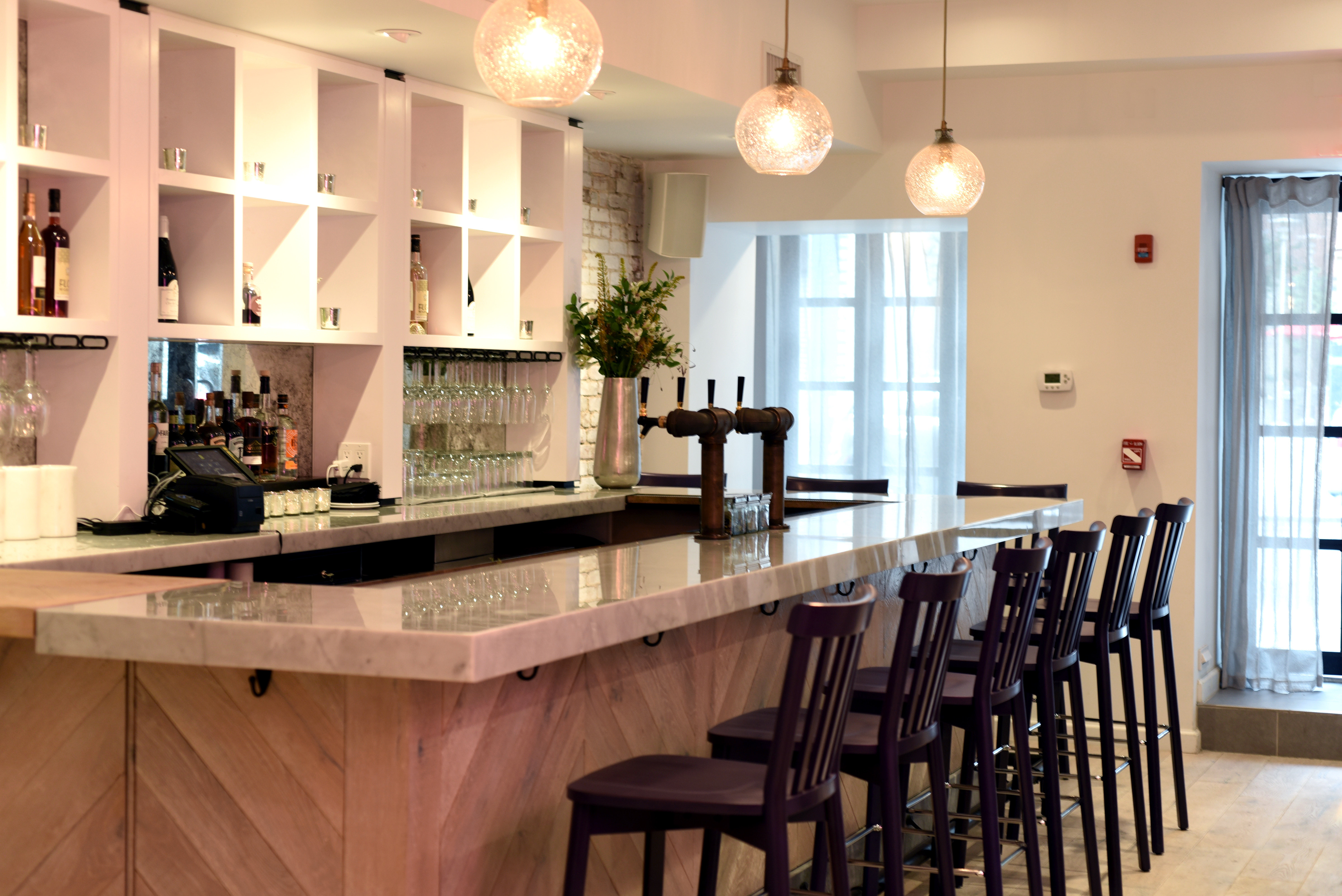 Enjoy a drink at the P.S. Kitchen bar