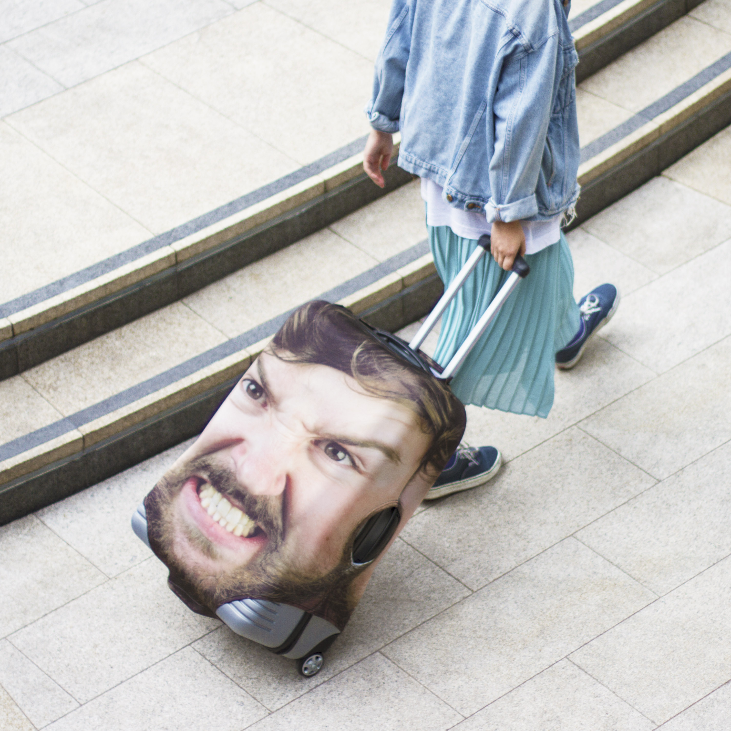 You'll never be confused which suitcase is yours again - if it has a giant picture of your face on it