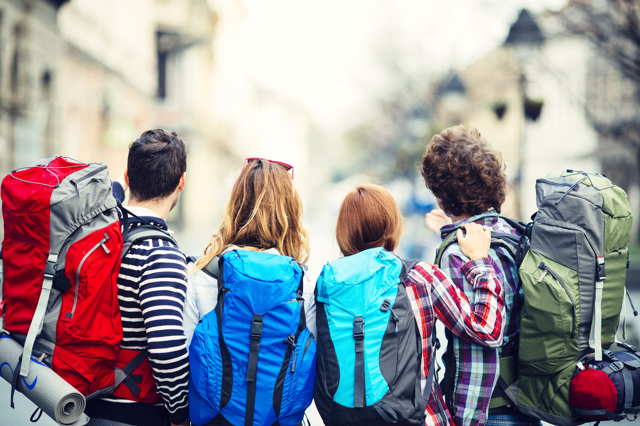 Rear view of young backpackers in the city. Looking forward in down town street of Knez Mihailova, Belgrade, Serbia.