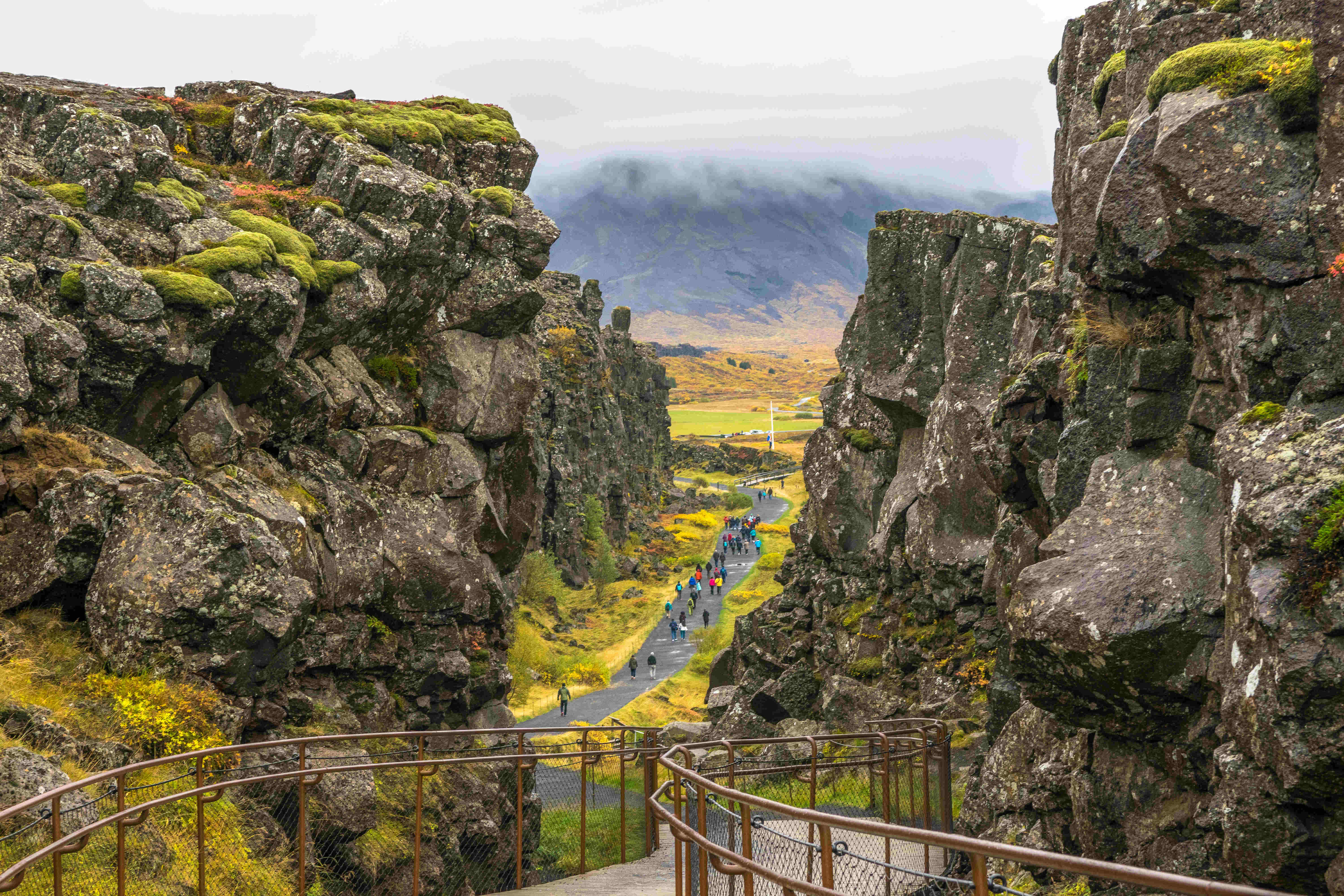 Beautiful view of people walking in the seam between the Eurasian and North American tectonic plates.