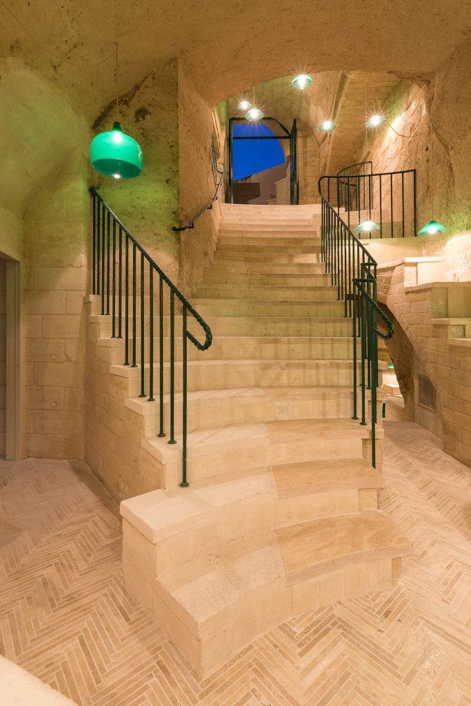 Enoteca dai tosi winery in Matera with stone steps and green venetian lighting