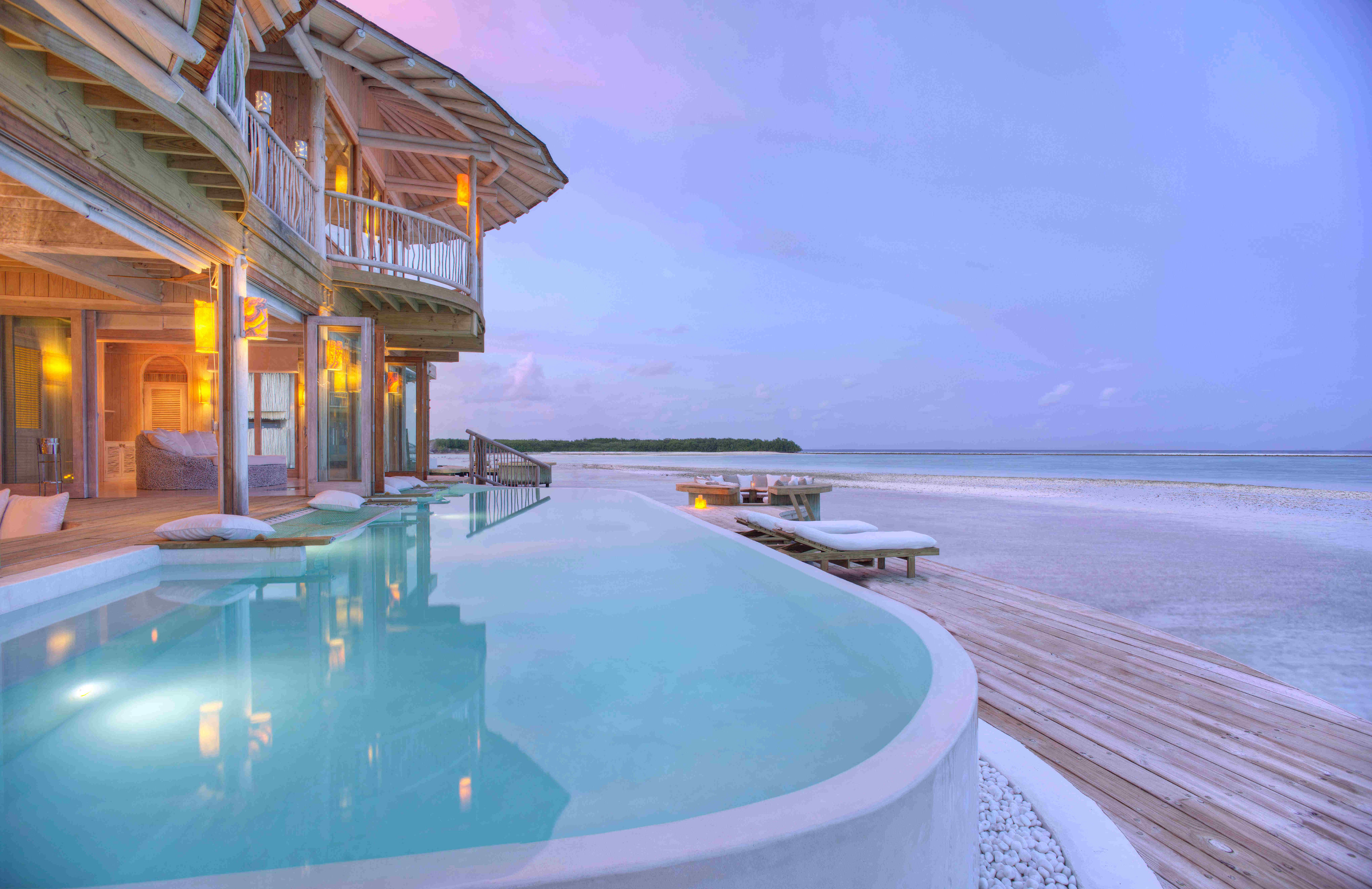 These Villas In The Maldives Have Slides To Take You Right