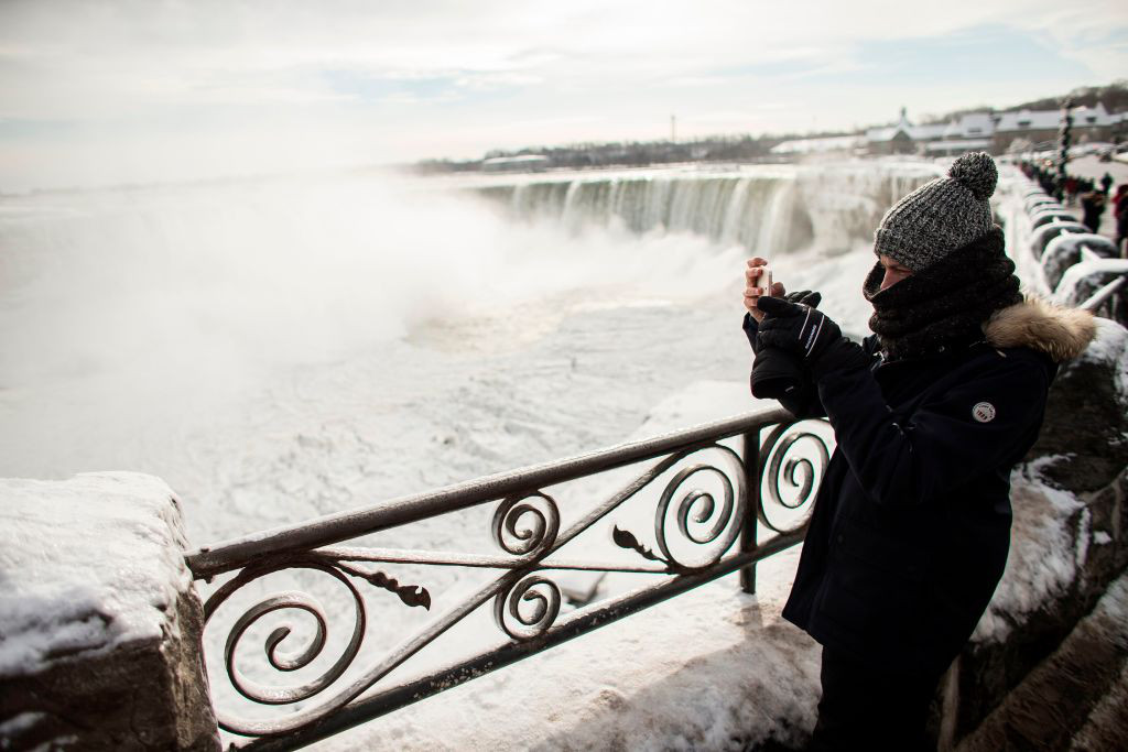A Frozen Niagara Falls Is Attracting Tourists To A Winter