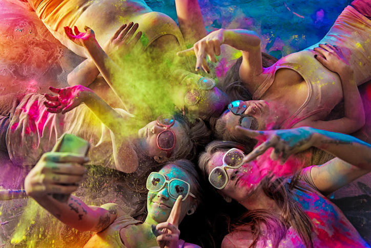 Group of Young Women covered with holi powder