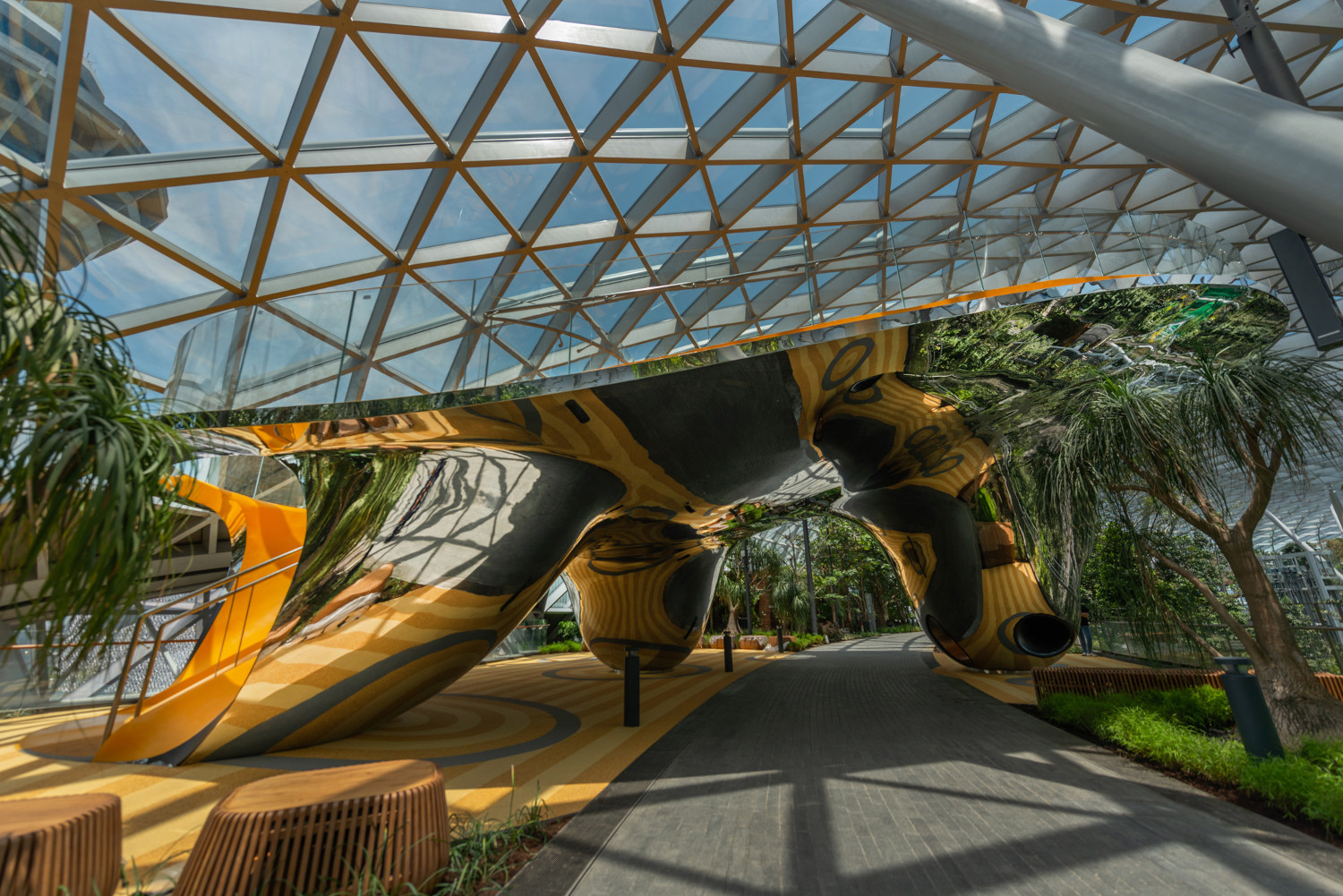 The Discovery Slides are set within a reflective sculpted art installation.
