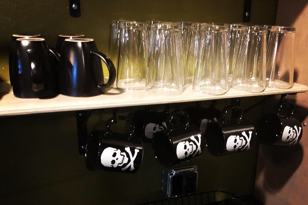 Mugs and glasses at The Black Monarch Hotel.