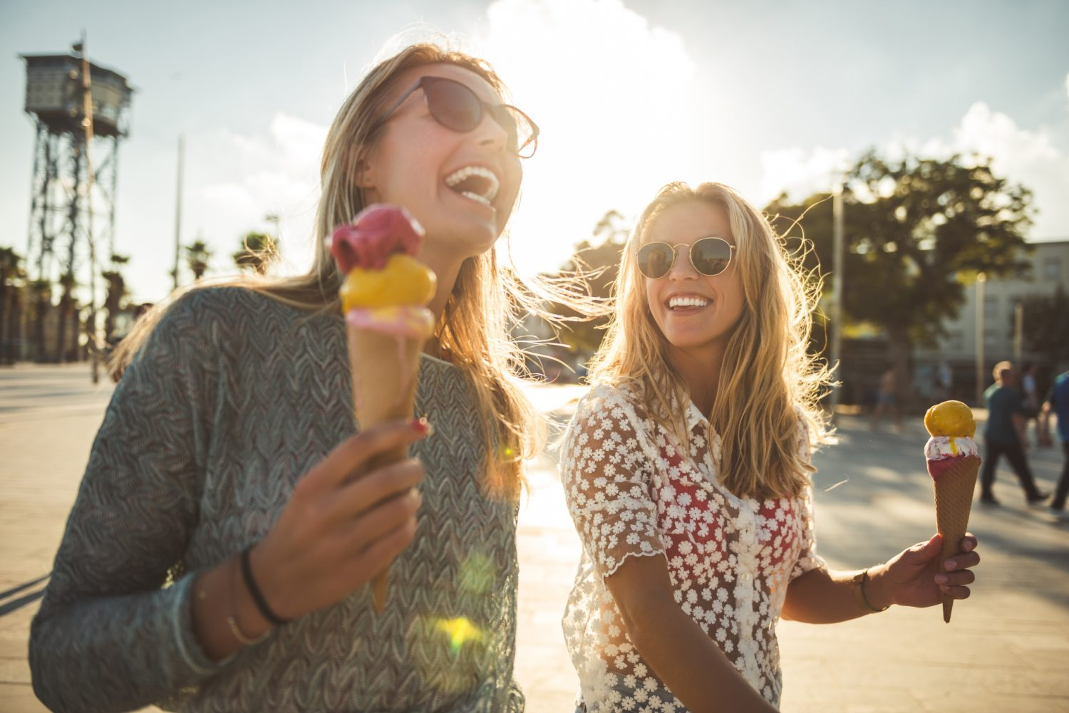 Two women eating ice cream and laughing